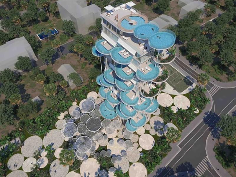 Escritório de arquitetura desenha prédio com estilo futurista e piscinas individuais em cada apartamento